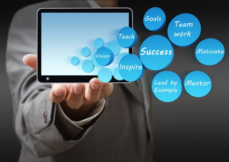 business hand shows success icon diagram and tablet computer